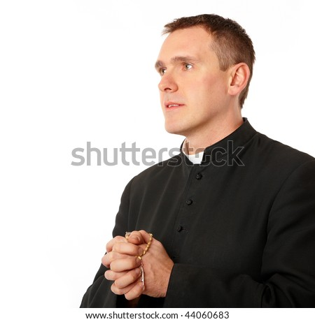 Young priest with rosary in his hands