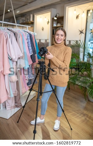 Young professional. A young photographer using a tripod while working