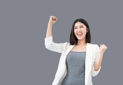 Young professional Asian woman raising her arms up feeling cheerful triumphant happiness and successful celebrating business or successful job, the concept of successful emotional, Clipping path embed