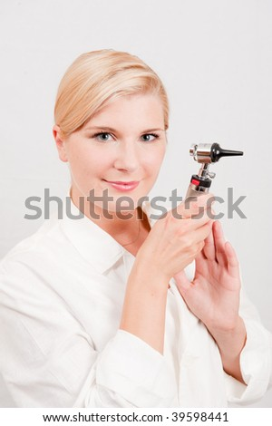 ... optimistic female doctor with tool for ear examination - stock photo