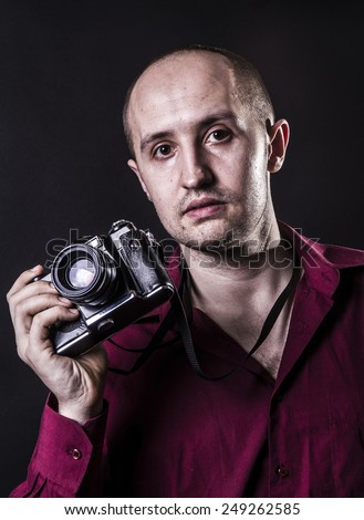 Young professional photographer with old retro film camera #249262585