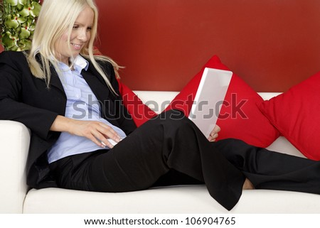 Young professional woman working from home on her laptop