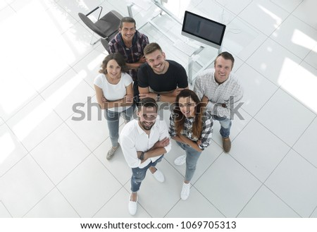 young professionals standing near the desktop