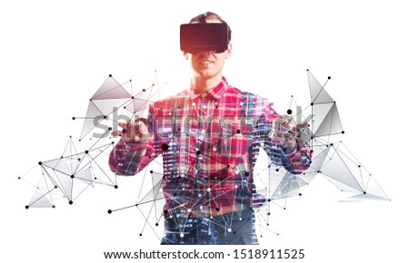 Young programmer wearing VR headset working with virtual model. New reality modeling and design. Interacting with virtual interface. Mixed media with 3d objects. Cyberspace simulation technology