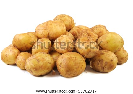 Young raw potato . Isolated over white background.