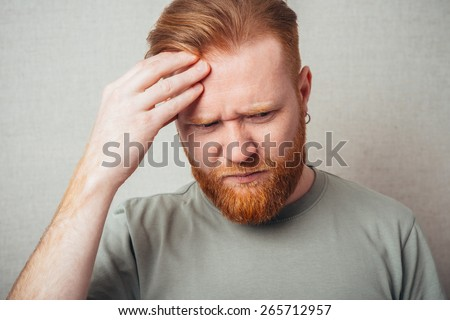 Young red bearded Man having a headache