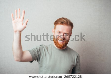 Young red bearded Man saluting