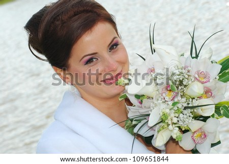 Young redhead bride posing for the camera