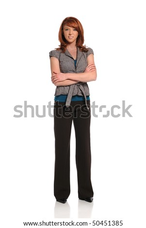 Young redhead businesswoman standing with arms crossed
