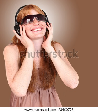 Young Redhead Listening to Music on Headphones