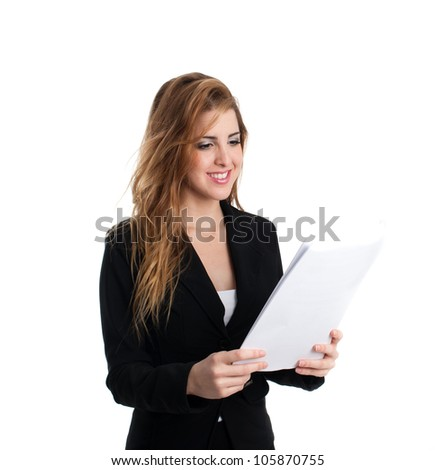 Young redhead secretary reading some papers - stock photo