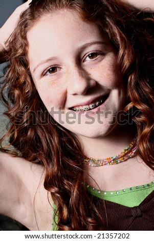 stock photo : Young redhead teen smiling. Save to a lightbox ▼