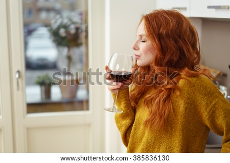young redhead woman standing in ...