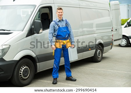 Young Repairman With Tools And Toolbox Standing In Front Of Service Van #299690414