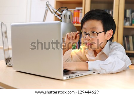 Young researcher with glasses on looking at computer