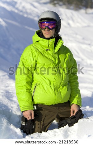Young rider on the snow looking for a ski slope