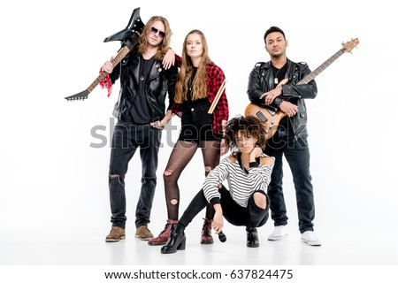 Young rock and roll band standing with microphone, drumsticks and guitars isolated on white  #637824475