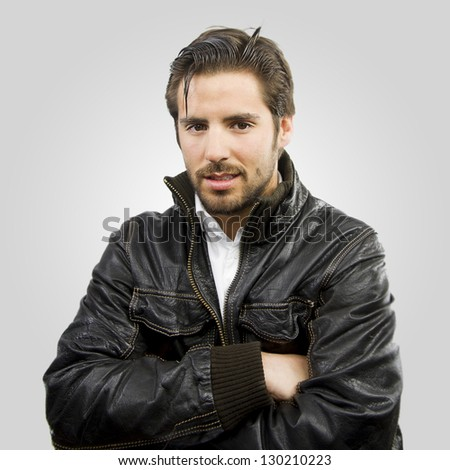 young rocker handsome man fur jacket