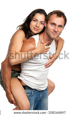 Young romantic couple having fun in studio over white background