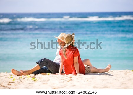 Young romantic couple on white sand beach
