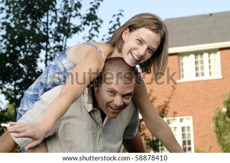 Young romantic couple spends afternoon playing in their garden.
