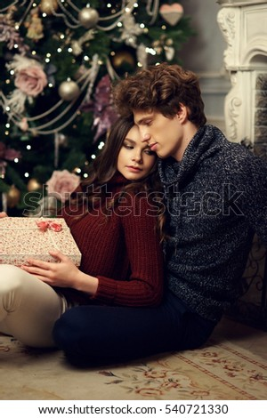 young romantic cute couple staying at home and enjoying time together lovers hugging in christmas