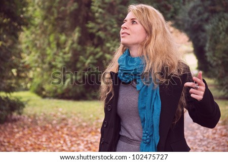 Young romantic lady in forest