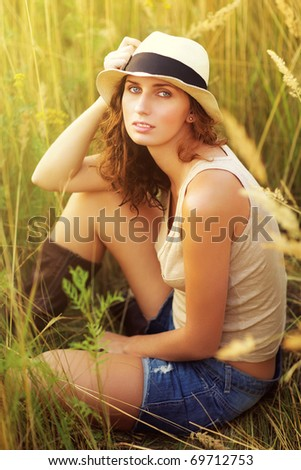 Young romantic woman outdoors portrait. - stock photo