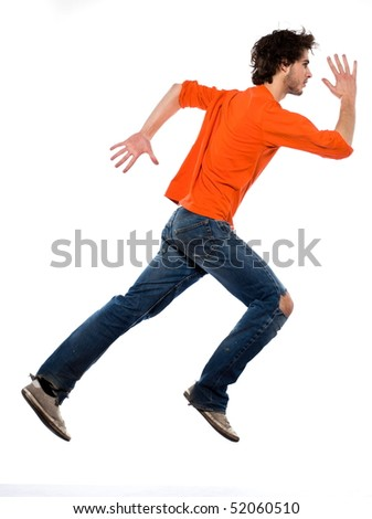 young running caucasian man portrait in studio on white background
