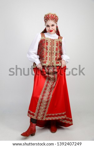 Young Russian girl in Russian folk costume in red #1392407249