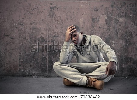 Young sad african man