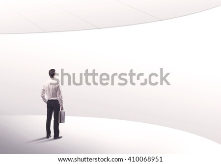 Young sales business person in elegant suit standing with his back in empty white space background with curved lines concept #410068951