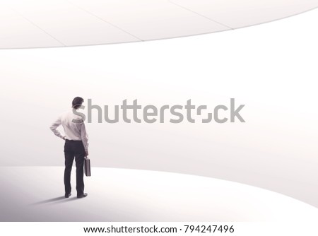 Young sales business person in elegant suit standing with his back in empty white space background with curved lines concept #794247496