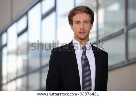 Young salesman in smart suit