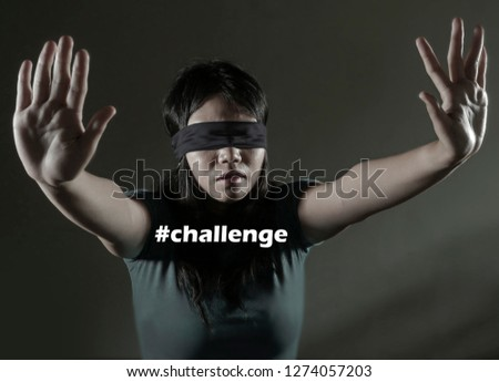f4b5f6a44ab young scared and blindfolded Asian Chinese teenager girl lost and confused  playing dangerous internet viral challenge
