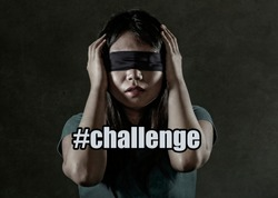 f8c4433891e young scared and blindfolded Asian Korean teenager girl lost and confused  playing dangerous internet viral challenge. Businessman ...