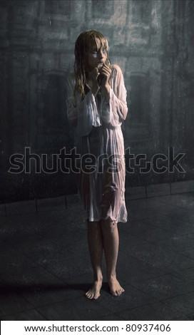 Young scared girl under the rain