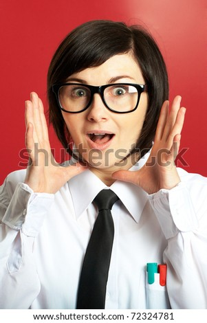 young scared or surprised female in glasses on red background