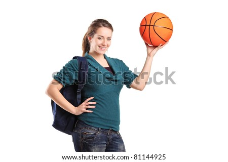 Young school girl holding a basketball isolated on white background