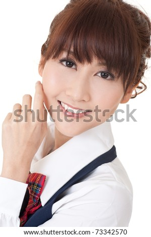 Young school girl of Asian smiling, closeup portrait.