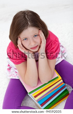 Young school girl with headache from fatigue - stock photo