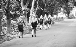 Young school going girls are walking on an empty road isolated unique photograph