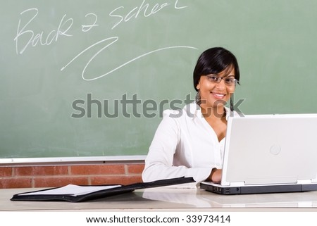 young school teacher working in the classroom