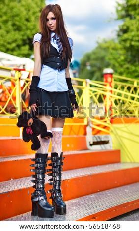 Young schoolgirl in amusement park.