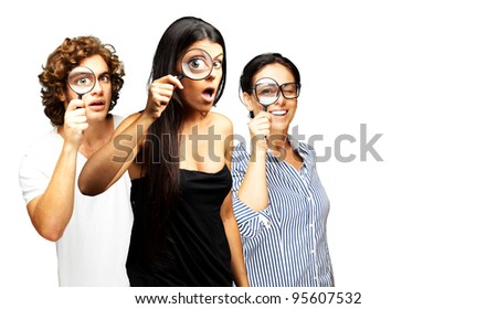 young scientist looking through a magnifying glass over white background
