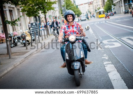 Young scooter driver in the streets of Berlin Mitte #699637885