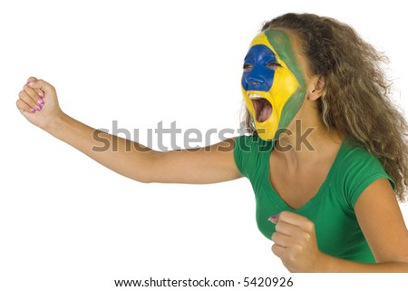 Young screaming Brazilian fan with painted flag on face. White background, side view