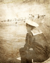 Young seaman dreaming. Photo in vintage image style.