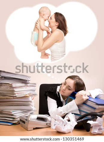 Young secretary with a lot of folders sleeping and dreaming of baby