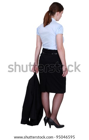 young secretary with jacket trailing behind her